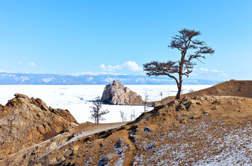 Lake Baikal in early spring. Olkhon island in a non-tourist season. There are no tourists on Cape Brhan, the Wish Tree without colored ribbons. Ice drift in the Small Sea. Calm spring landscape