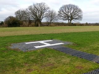 Helicopter landing pad on farmland at Sarratt, Hertfordshire, England, UK