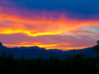 beautiful sunset with the landscape of majorca with the silhouette of the tramuntana mountains in the background