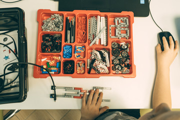 Minsk, Belarus. December, 2019. Boys and girls construct and code Lego Mindstorms EV 3 robot. STEM and STEAM education. Robotics class for child and teen.