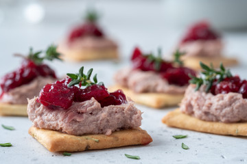 Rosemary Cracker with pate and cranberry sauce