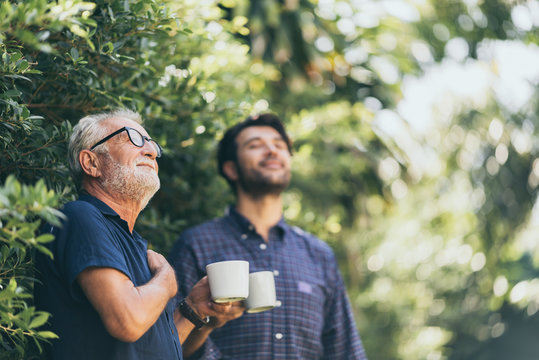 Old father and son, Morning coffee in a garden