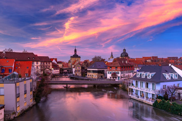 Wall Mural - Aerial panoramic view of Old town hall or Altes Rathaus with bridges over the Regnitz river at sunset in Bamberg, Bavaria, Upper Franconia, Germany