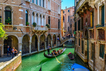 Garden Poster Venice Narrow canal with gondola and bridge in Venice, Italy. Architecture and landmark of Venice. Cozy cityscape of Venice.