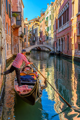 Keuken foto achterwand Gondolas Narrow canal with gondola and bridge in Venice, Italy. Architecture and landmark of Venice. Cozy cityscape of Venice.