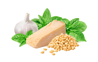 Fresh pesto ingredients, green basil leaves, garlic bulb, parmesan cheese and pine nuts isolated on white background