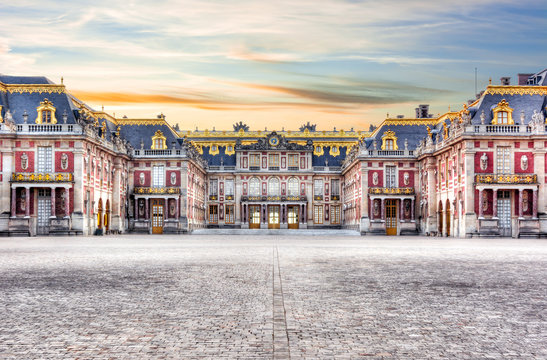 Medieval Versailles palace outside Paris at sunset, France