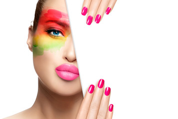 Beauty and Makeup Concept. Pink Nail Art and Colorful Make-up.