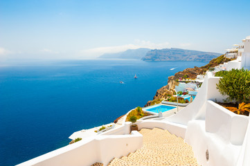 White architecture and blue sea on Santorini island, Greece. Stairs to the sea. Summer holidays, travel destinations concept