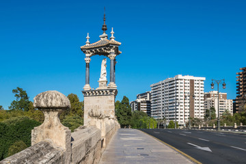 Gothic bridge Pont del Real with the sculpture of Saint Vincent Ferrer in Valencia, Spain
