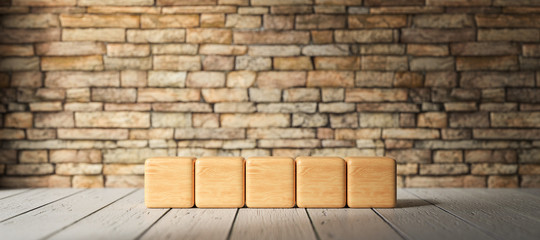 five empty wooden blocks for own text in front of a brick wall