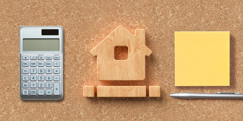house symbol on cork background with office items