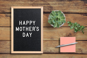 letter board with message HAPPY MOTHER'S DAY on wooden background