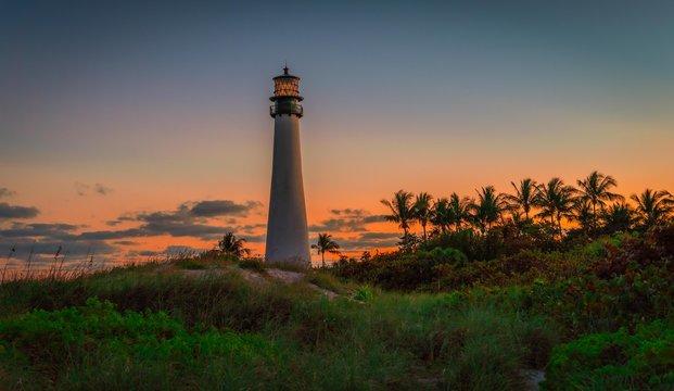 lighthouse lighthouse coast beach ocean building tower landscape florida architecture white nautical blue water landmark