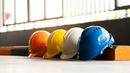 Safety Construction Worker Hats Blue, white, yellow, orange. Teamwork of construction team must...