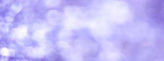 Purple abstract background with bokeh defocused lights