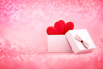 The red Heart shapes  in gift box on sweet pink background , the love concept for valentines day with sweet and romantic moment