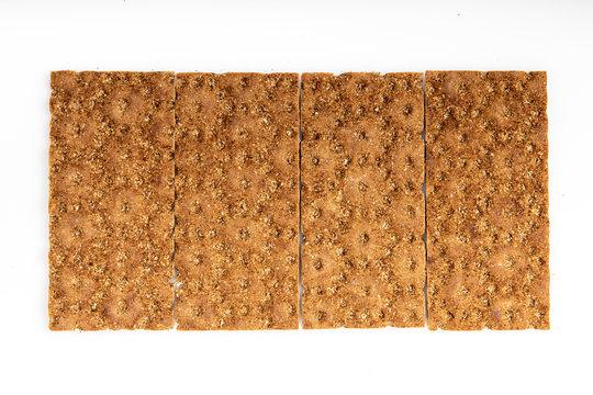 Grain diet light crisp bread lying on a white background
