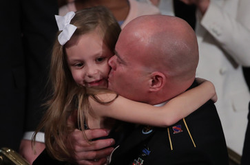 Sgt. 1st Class Townsend Williams surprises family at the State of the Union address by U.S. President Donald Trump in Washington