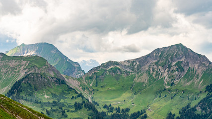 Poster Khaki Switzerland, Panoramic view on green Alps near Schynige Platte, Saxeten