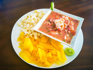 Ecuador food: fish ceviche, raw fish. with popcorn and plaintain.