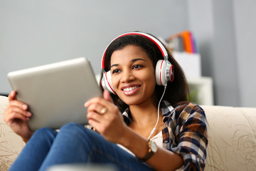 Black ordinary female american teen portrait at home sofa remote education concept. Girl hold...