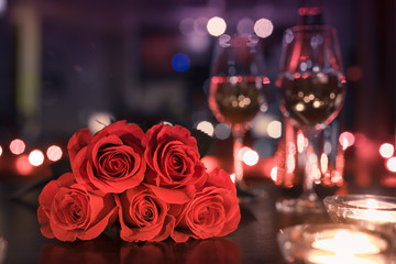 Wall Mural - red roses and candles in dinner setting