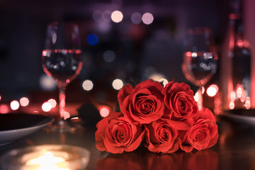 Wall Mural - Beautiful romantic dinner date night setting with roses and wine