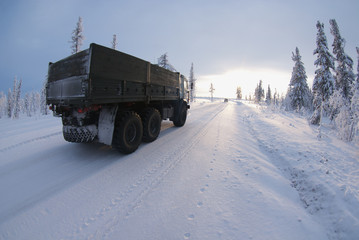 Far North. The truck is moving along the winter road.