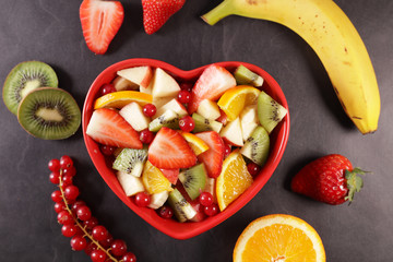 fresh fruit salad in heart bowl