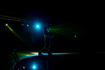 Dark silhouette of a singer on the stage.