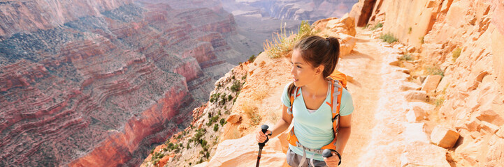 Hike panoramic banner of woman hiker traveling alone trekking in Grand Canyon National park of...