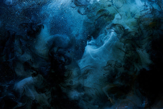 Abstract blue outer space science background. Vibrant colors galaxy sky, ocean, sea. Mystical liquid chemicals smoke, chemistry and biology creative backdrop paper