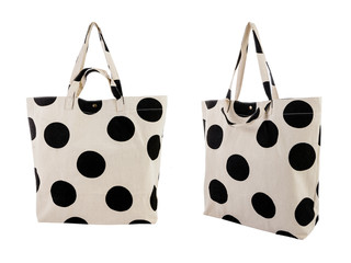 White canvas bag with random black dots pattern isolated on white background.