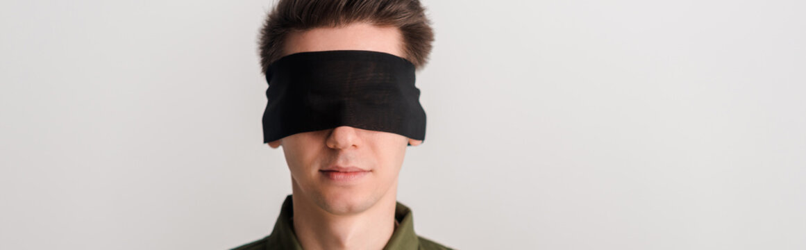 panoramic shot of blindfolded man isolated on white, human rights concept