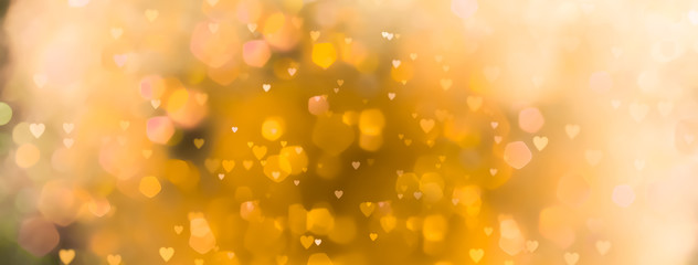 Fototapete - abstract yellow background with bokeh lights  and many - hearts   - Love  - spring, summer, easter