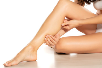 woman massaging her painful leg