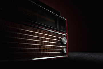 Red radio on dark background. Close up of old retro things shooted with vintage style colors and...
