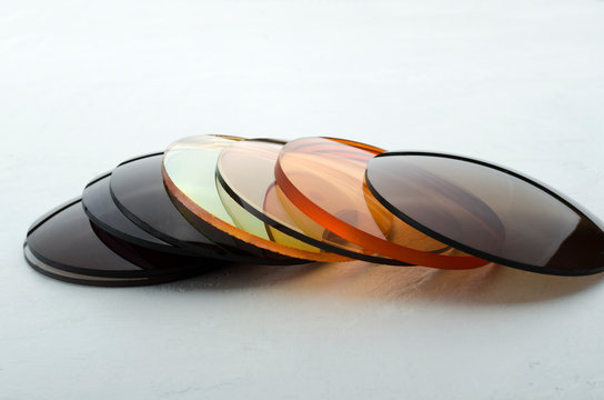 Closeup of different colored optical corrective lenses for eyewear