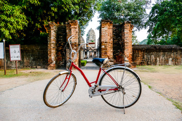 Aluminium Prints Bicycle bicycle in front of old house, digital photo picture as a background