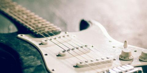 Sound. Professional guitar. Close up of old retro things shooted with vintage style colors and...