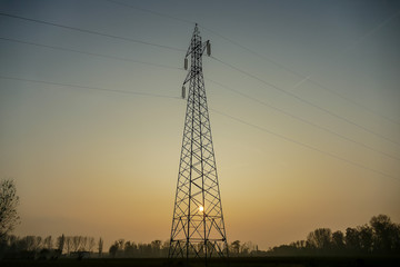 high voltage tower at sunset, digital photo picture as a background