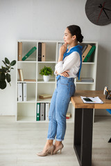 Image of asian secretary woman standing by table while working in office