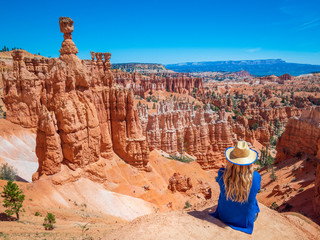 Young woman travels Bryce Canyon national park in Utah, United States, people travel explore nature. Bryce is a collection of giant natural amphitheaters distinctive due Hoodoos geological structures Wall mural