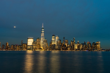 Lower Manhattan New York City Skyline at Night with the Moon