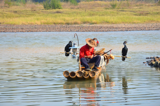 Cormorant Fisherman With His Raft at the Li River in Yangshuo, Guilin, China