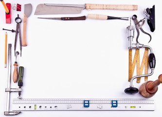 Different types of tools making frame on white background