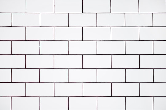 background of white ceramic classic rectangular tiles, wall in the bathroom