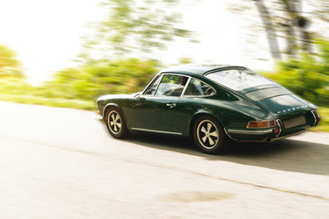 Old Porsche 911, vintage car running on country road. This model was built in 1969. Biella, Italy, September 24, 2017.