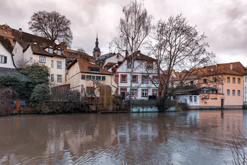 Fototapete - Scenic view of Old town over the Regnitz river in winter day in Bamberg, Bavaria, Upper Franconia, Germany